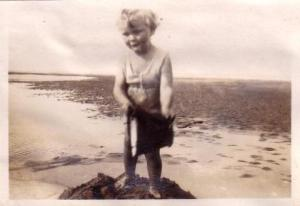 Martin Neville as a small child on the beach