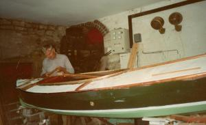 Martin Neville building a Humber Yawl. His domestic hydro-electric plant can be seen behind him.